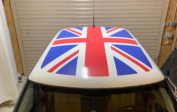 Mini Cooper semi-covering English flag roof